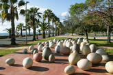 The coastal town of Limmasol: A view of the seafront with a modern stone sculpture in the foreground